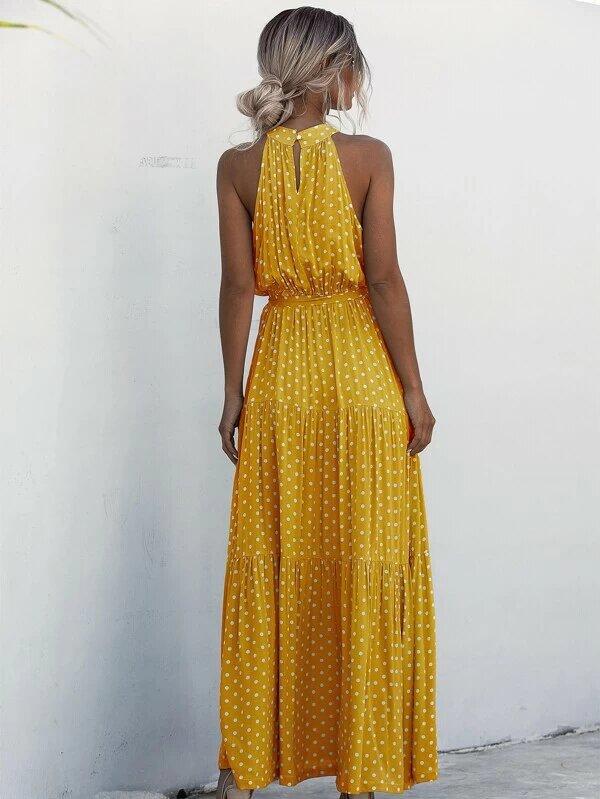 Vestido vuelos amarillo espalda